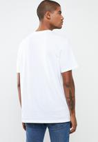 Levi's® - Oversized graphic tee logo stripe - white