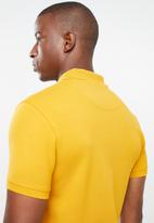 POLO - Stretch pique golfer - yellow