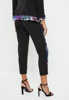 RUFF TUNG - Sequin slouch trousers - black