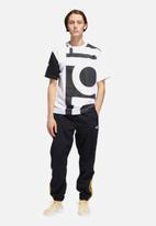 adidas Originals - Woven block pants - black & yellow