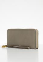 Fossil - Logan zip around purse - light taupe