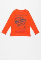 name it - Race day print ls top - orange & navy