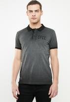 S.P.C.C. - Reverse dirty dye pique golfer - black
