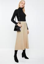 MANGO - Knitted flared midi skirt - beige
