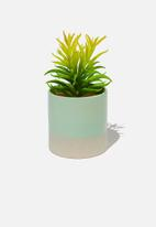 Typo - Shaped planter with plant - green & grey