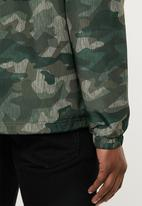 New Balance  - Essentials coaches jacket - green
