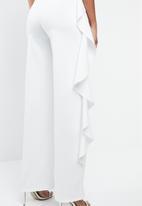 MANGO - Frilled one-shoulder jumpsuit - white