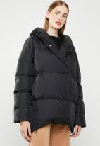 MANGO - Quilted oversized puffer - black