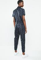 Nike - Nike air jumpsuit - black