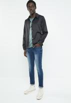 S.P.C.C. - Feather signature jeans - blue