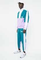 New Balance  - NB athletics windbreaker pant - green & white