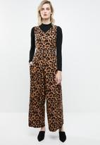 Superbalist - Woven jumpsuit with tie back - brown & black