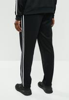New Balance  - Athletics track pant - black