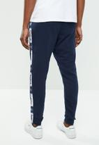 Reebok Classic - CL FT taped pant - blue