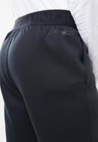Under Armour - Move light graphic pants - black