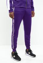 Mennace - Tricot knit Mennace race stripe tracksuit bottoms - purple