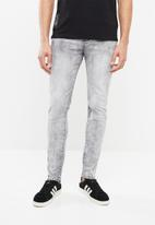S.P.C.C. - Sabre jeans in heavy bleach wash - grey