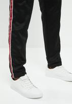 Mennace - Tricot regular fit knit tracksuit bottom - black & red