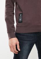 S.P.C.C. - Dirty dye logo crew neck sweater - purple