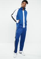 Nike - Nsw hbr pant pk stmt - blue