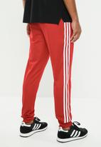 adidas Originals - SST track pants - red & white