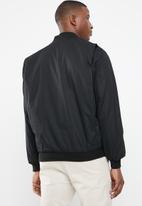Pringle of Scotland - Augusta reversible jacket - black & brown
