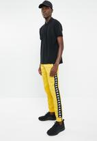 KAPPA - Arib slim fit pants - yellow