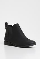 Call It Spring - Faux leather side elastic slip-on ankle boot - black