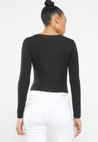 c(inch) - Long sleeve scoop neck bodysuit - black