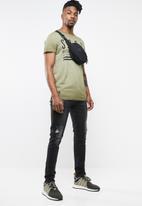 S.P.C.C. - The ebony ripped jeans - black