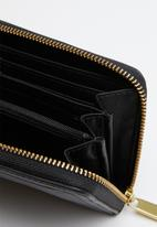 Fossil - Logan zip clutch - black