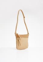 BLACKCHERRY - Tassel detail cross body square bag - neutral