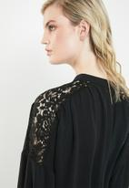 Vero Moda - Paula blouse with lace shoulder - black