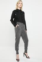 Vero Moda - Githa Kelly jersey pants - black & silver