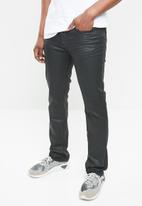 GUESS - Skinny jeans - black