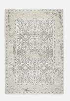 Sixth Floor - Antique printed rug