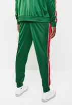Superbalist - Slim fit cuffed side stripe tricot pant - green & red