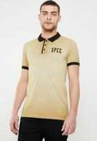 S.P.C.C. - The mirage polo - beige & black