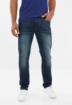 GUESS - Costel slim fit tapered jeans - blue