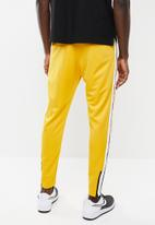 Nike - M nsw nsp track pant - yellow