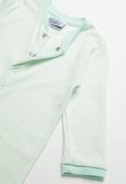 POP CANDY - Baby boys sleepsuit - green & white