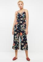 Revenge - Strap detail tropical jumpsuit - multi