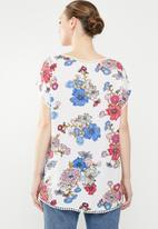 Revenge - Short sleeve floral top with pom pom detail - multi