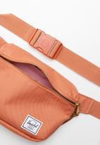 HERSCHEL - Fifteen hip pack - orange