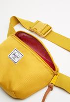 Herschel Supply Co. - Fourteen hip pack - yellow