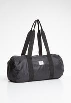HERSCHEL - Packable duffle bag - black