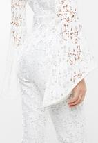 Missguided - Lace long sleeved v neckline jumpsuit - white