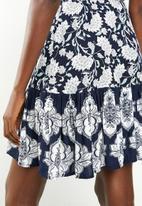 Revenge - Wrap over floral dress with contrast border - navy
