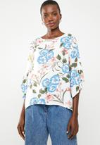 Revenge - Bell sleeve washed floral top - multi