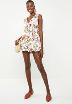 Revenge - Floral playsuit with front bow - multi